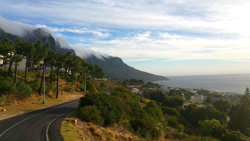 Mountain Road No People Landscape Nature Capture The Moment Sky Scape EyeEmNewHere Foamy Clouds Foamy Mountains Clouds Over Mountains Cape Town, South Africa Cape Town Table Mountain Amazing View Beautiful Mountain Nature Architecture Wonderful View Breathing Space Scenics Landscape Seascape Sea And Sky Seascapes Sea_sky_nature Houses In Background Houses In The Nature Lost In The Landscape Perspectives On Nature Be. Ready.