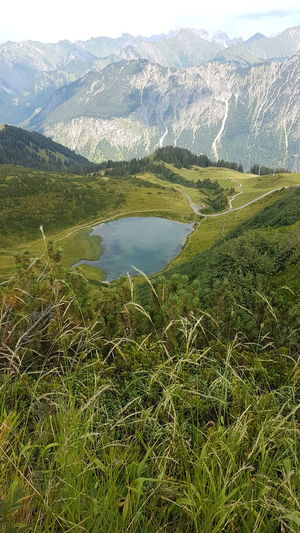 Silence Sereen Serenity Piece Mountain Herbs Grasses High Summer On Top Climbing Outdoors No People Steep Serenety High Up Mountains Top Of The World Clouds And Sky Wide View Moutain And Sky Moutain Top Lake Mountain Lake Water Mountain Lake Sky Mountain Range Grass Landscape