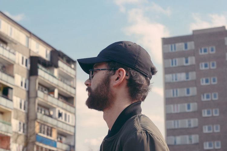 Man against buildings in city