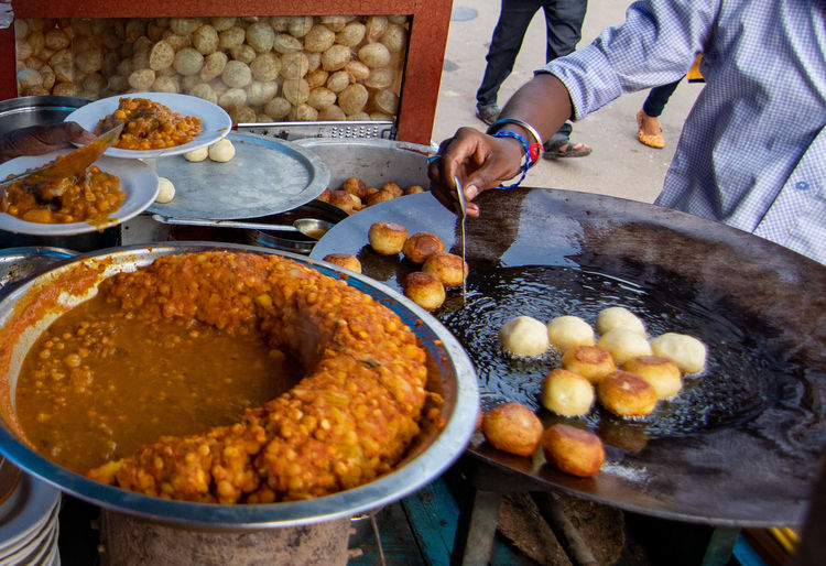 High angle view of man preparing food at market