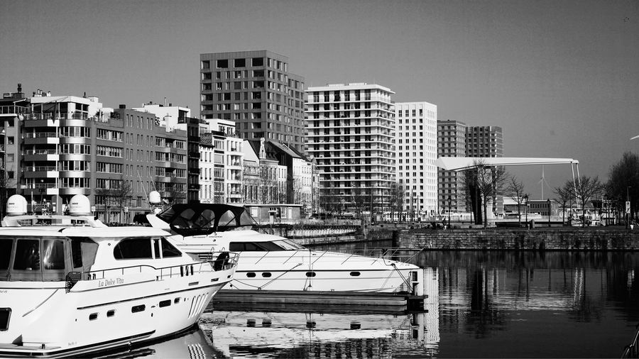 Antwerpen Harbor Touristic Destination Travel EyeEm Best Shots - Black + White Blackandwhite Yachts Port Building Exterior Built Structure Architecture City Mode Of Transportation Transportation Building Water Residential District Reflection City Life Cityscape No People Motor Vehicle