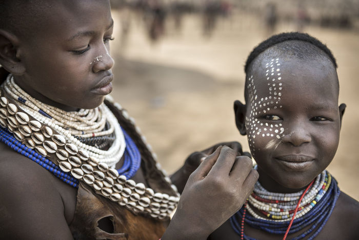 Two children from Karo tribe, Omo Valley, Paint their face. Africa Body Painting Childhood Ethnicity Focus On Foreground Front View Headshot Human Face Karo Person Portrait Smiling Travel Traveling Tribe