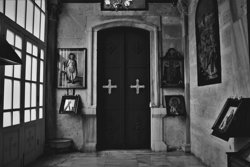 the church EyeEm Best Shots EyeEm Gallery Bnw_collection EyeEm Selects Bnw Bnw_friday_eyeemchallenge Bnw_captures Bnwphotography Bnwmood Eye4photography  EyeEmNewHere Istanbul Turkey Door Built Structure Closed Door Sculpture Historic Door Handle Latch Front Door Entry Entrance Closed Human Representation Carving - Craft Product Idol Female Likeness Male Likeness Statue Entryway Sculpted Door Knocker Golden Color Flaming Torch