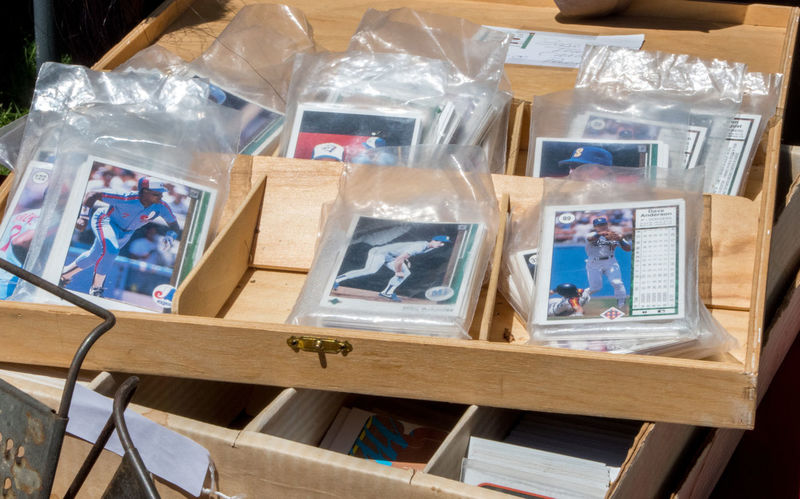 bags of old baseball cards are packaged for sale at an antique event in Michigan USA Sale Abundance Bag Baseball Cards Box Cards Choice Close-up Collectable Items Collecting Baseball Cards Collection Container Day Editorial  Frame Large Group Of Objects Nostalgia Paper Plastic Bag Rare Still Life Table Transparent Variation Vintage