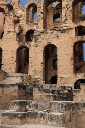 The amphitheater in El Jem, Tunisia Africa Amphitheater Arches Architecture Arena Colosseum El Jem Empire Erosion Famous Fight Gladiator Heritage History Landmark Mediterranean, Monument Old Place Roman Empire Ruin Stone Travel Tunisia UNESCO World Heritage Site