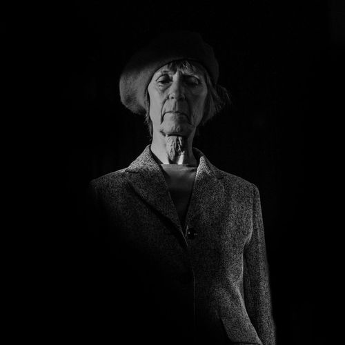 January 2018 EyeEm Selects Black Background Portrait Beautiful Woman Women Fine Art Portrait Time Human Face Dark Studio Shot Thoughtful Pensive Vintage Film Noir Style