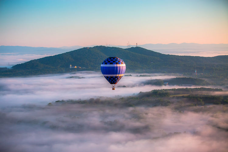 View Of Hot Air Balloon Above Clouds