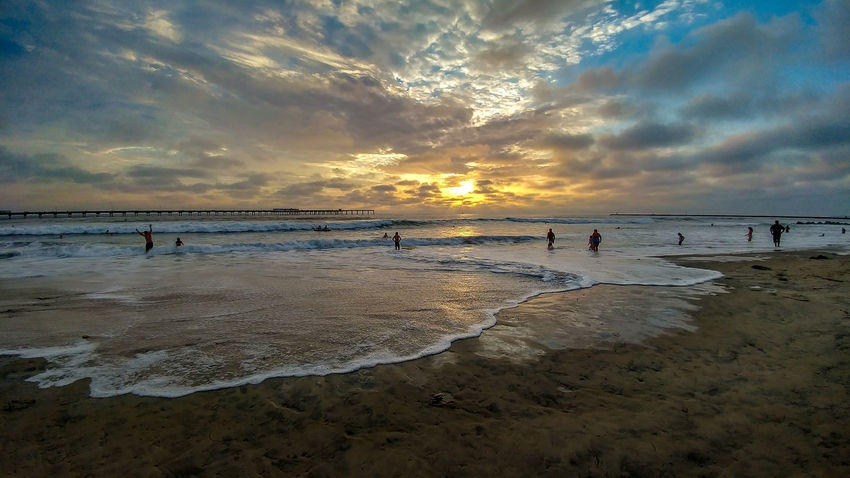 Ocean Beach Sunset Pier San Diego Beach Beauty In Nature Cloud - Sky Group Of People Horizon Horizon Over Water Incidental People Land Large Group Of People Nature Ocean Beach Outdoors Sand Scenics - Nature Sea Sky Sunset Tranquil Scene Tranquility Water Wave