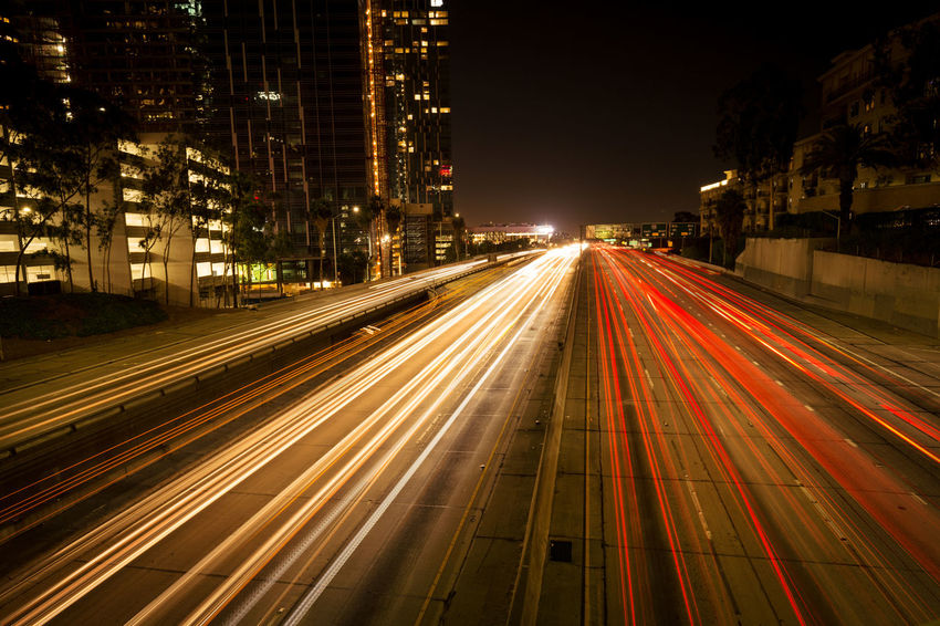 LA Traffic - Architecture Blurred Motion Building Exterior Built Structure City City Life Cityscape Illuminated Light Trail Long Exposure Motion Night No People Outdoors Road Speed Street Street Light Traffic Transportation