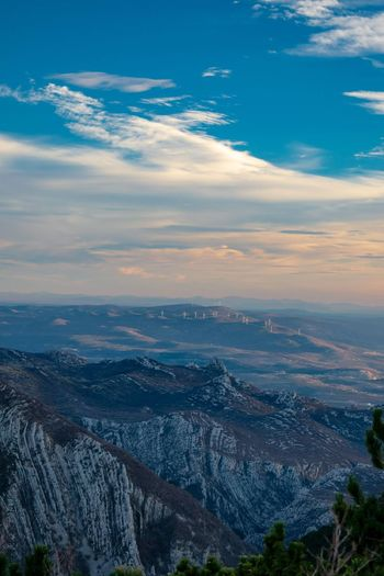 Windmills in the distance. Nature Photography Nature Croatia Wilderness Sky Mountain Sunset Blue Calm Panoramic Valley