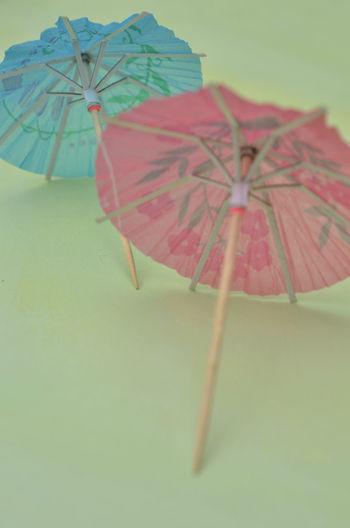 mini paper drink umbrellas, cocktail umbrellas, cocktail parasols Blue Close Up Close-up Cocktail Parasols Cocktail Umbrella Day Drink Umbrella Floral Pattern No People Outdoors Paper Umbrellas Pink Color Yellow Color