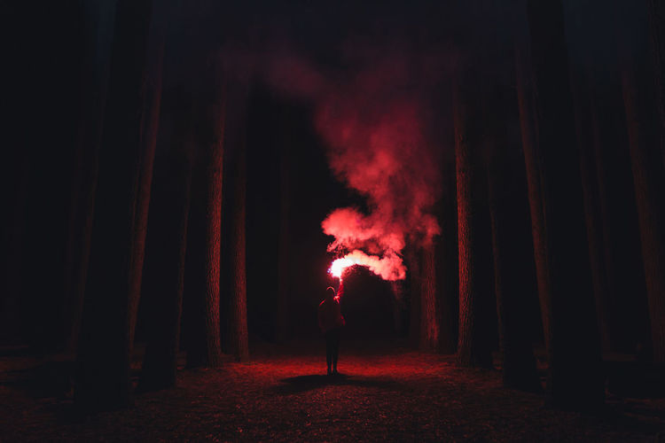 Adult Adults Only Alone Burning Flare Forest Full Length Illuminated Men Night One Man Only One Person Only Men Outdoors People Performance Real People Red Stage - Performance Space Standing Young Adult The Week On EyeEm TCPM Break The Mold The Traveler - 2018 EyeEm Awards