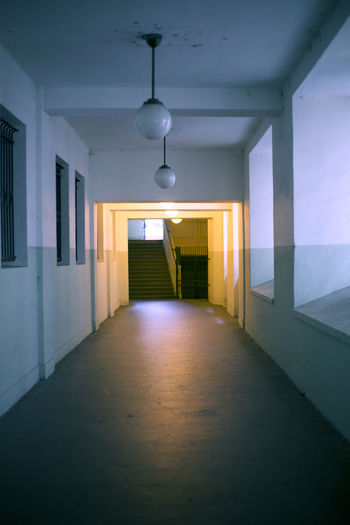 Empty corridor in illuminated room