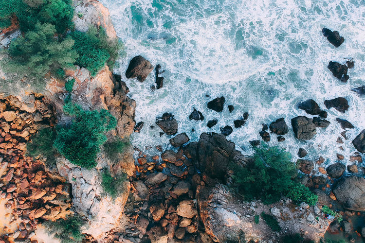 Rock Solid Rock - Object Sea Water Motion High Angle View Beauty In Nature Nature Land Day No People Beach Wave Sport Outdoors Aquatic Sport Rock Formation Power In Nature Breaking Eroded