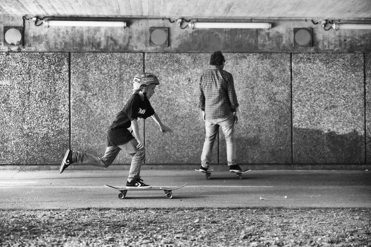Rear view of man skateboarding on skateboard