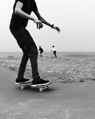 Real People Leisure Activity Sea Lifestyles Sand Beach Clear Sky Black And White Friday Two People Sky Low Section Men Nature Shotoniphone7plus IPhone7Plus IPhone 7 Plus מייאייפון7 מייסקייט מיישחורלבן Black And White מייסטריט Welcome To Black Out Of The Box The Street Photographer - 2017 EyeEm Awards Live For The Story