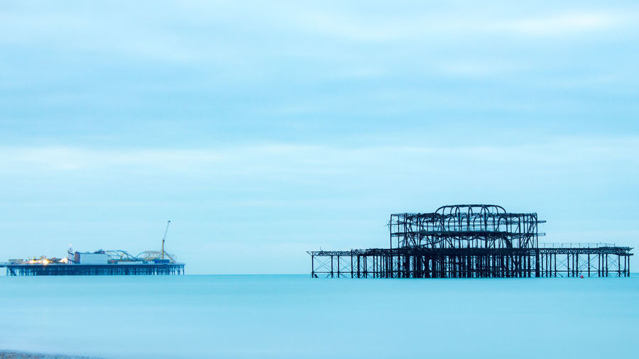 Ghost Pier England Brighton Beach Morning Early Morning Sunny EyeEmNewHere Blue Blue Water Water Aestethic Sea Oil Pump Offshore Platform Silhouette Sky Horizon Over Water Pier Shore Calm Seascape Tranquil Scene Stilt House Scenics Waterfront Headland Countryside Ocean Lakeside Sandy Beach