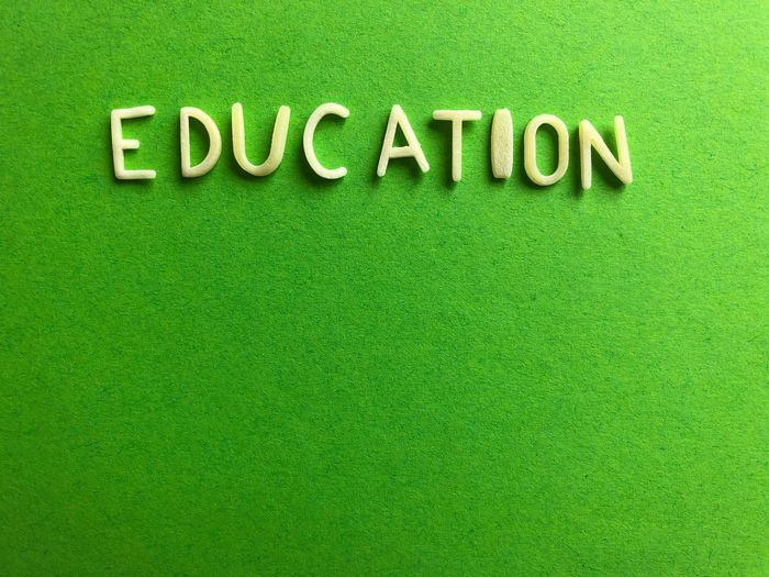 Close-up of text written on green background
