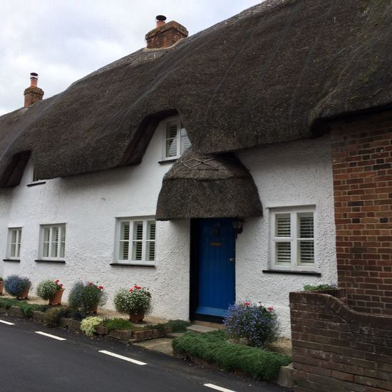 Architecture Blue Door Building Exterior Built Structure England, UK English Countryside Entrance Exterior House Old Thatched Roof Outside Plant Road Thatched Roof Window