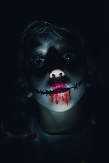 portrait of a young girl with Halloween make-up Make-up Halloween Black Background One Person Portrait Face Paint Spooky Looking At Camera Evil Halloween Dressing Up Child Costume Blood Standing Season  Trick Or Treat Scary Scary Face Horror Girl The Portraitist - 2018 EyeEm Awards