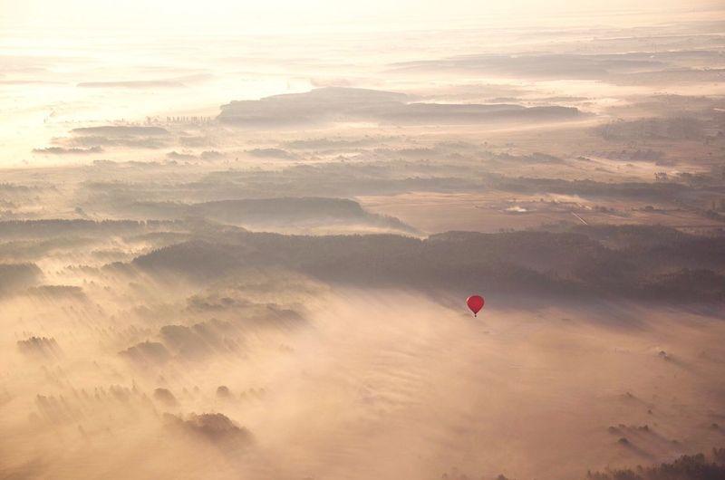 Hot Air Balloon In Desert Against Sky
