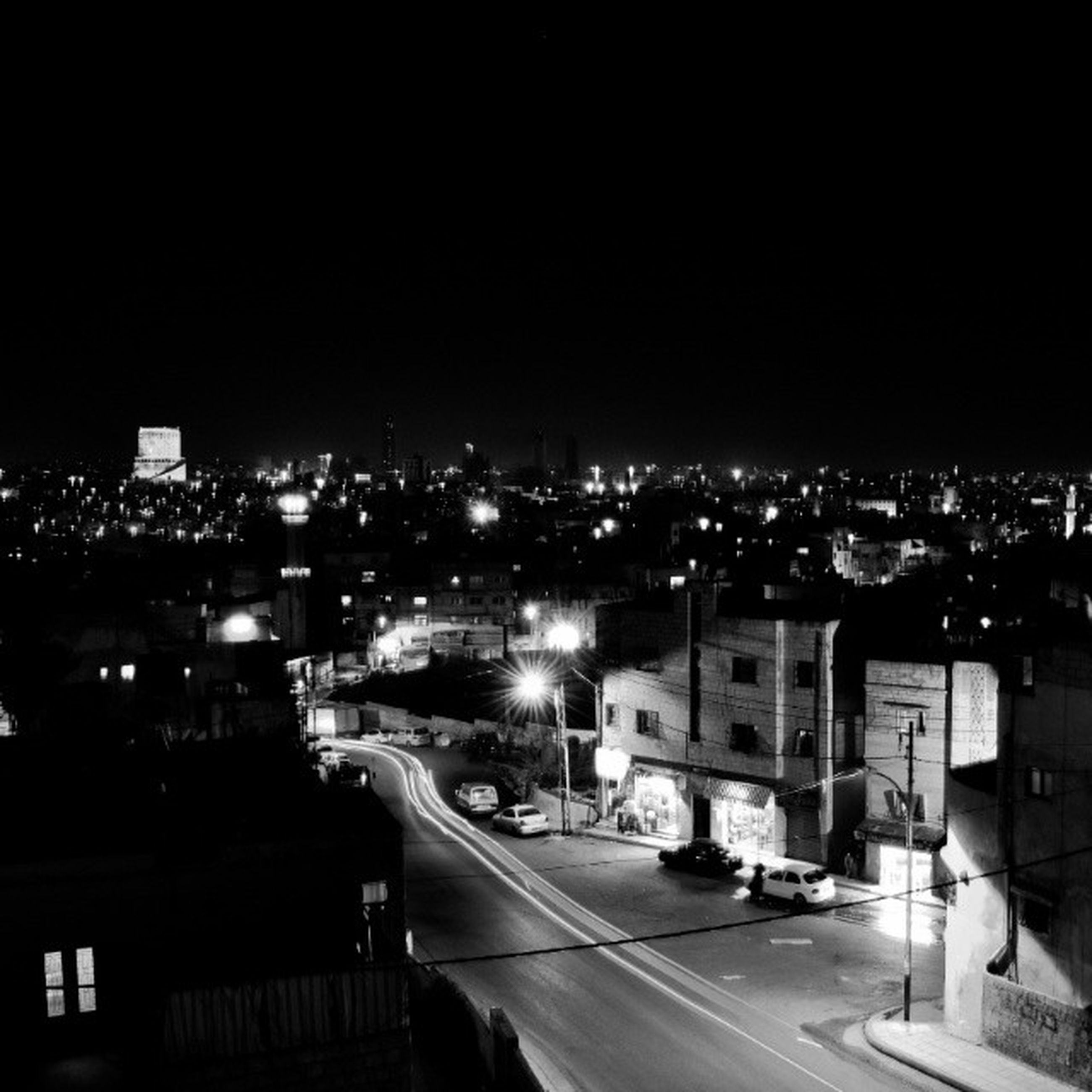 cityscape, building exterior, city, architecture, built structure, night, illuminated, crowded, high angle view, residential district, residential building, residential structure, city life, copy space, clear sky, aerial view, no people, sky, outdoors, road