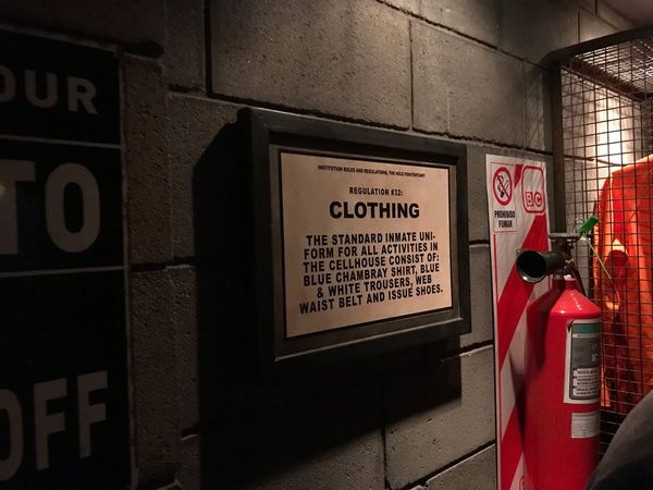 The Hole Clothing Warning Cellularphotography Prision Fire Extinguisher Communication Text Western Script Sign Information Information Sign Wall - Building Feature