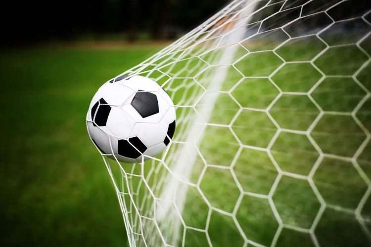 Close-up of ball on soccer field
