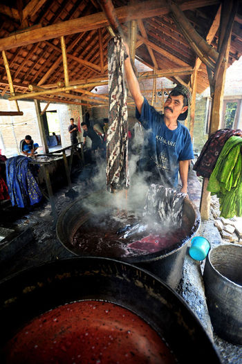 batik lasem Small Business Container Preparing Food Cooking Pan Smoke - Physical Structure Standing Business Day Men Occupation Preparation  Food And Drink Real People Freshness Adult One Person Working Indoors  Food