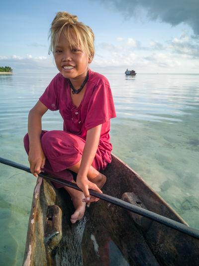 Sea Gypsy Nomadic Ethnic Maiga Island Island Semporna Sabah Malaysia People Sadness Happiness Uneducated Water Childhood Child Sea Nautical Vessel One Person Leisure Activity Real People Smiling Males  Nature Sky Men Transportation Boys Day Casual Clothing Outdoors Catch Of Fish