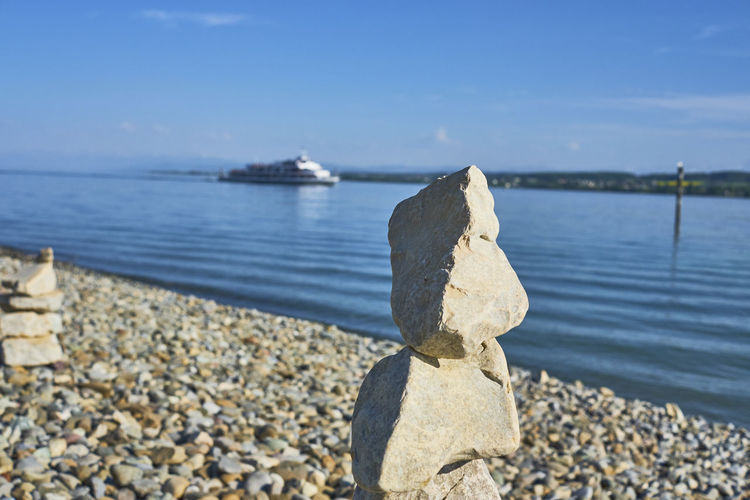 Beach Day Focus On Foreground Land Nature No People Outdoors Pebble Rock Rock - Object Sea Sky Solid Stone Stone - Object Sunlight Tranquil Scene Tranquility Transportation Water