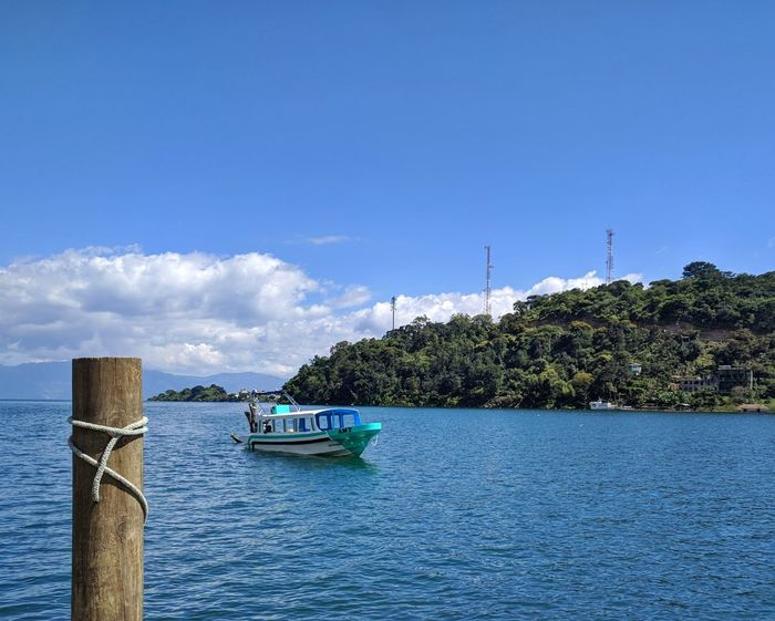 At the docks Water Nautical Vessel Outdoors Cloud - Sky Vacations Nature Blue Sky Day Travel Destinations Tranquility No People Sea Landscape Beauty In Nature Beauty Lake View Village Guatemala Tranquil Scene Tranquility Lake Traveling Central America Transportation