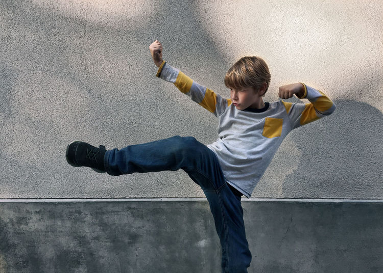Fighting Finn in front of a Wall with early evening light. Children Cool Kids Paint The Town Yellow Wall Balance Boy Day Fighting Flexibility Human Arm Human Body Part IPhoneography Motion One Person Outdoors People Strength Fresh On Market 2017
