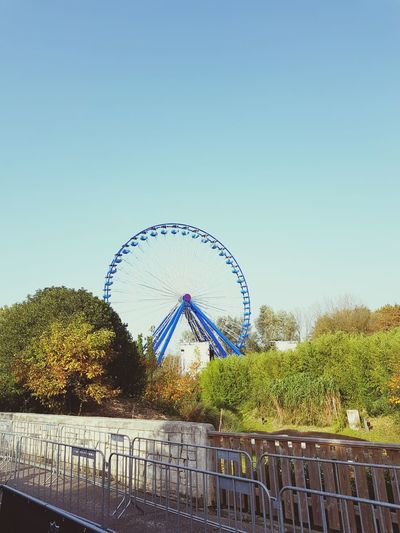 Amusement Park Arts Culture And Entertainment Ferris Wheel Amusement Park Ride Day Sky Outdoors Clear Sky Tree No People Nature