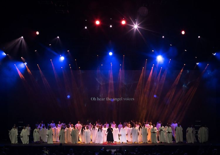 Choir Christianity Religion Large Group Of People Real People Men Night Women Arts Culture And Entertainment Mixed Age Range Religion Celebration Lifestyles Togetherness Audience Standing Performance Illuminated Full Length Popular Music Concert Sitting Crowd Indoors
