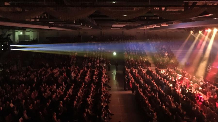 Crowd in illuminated room