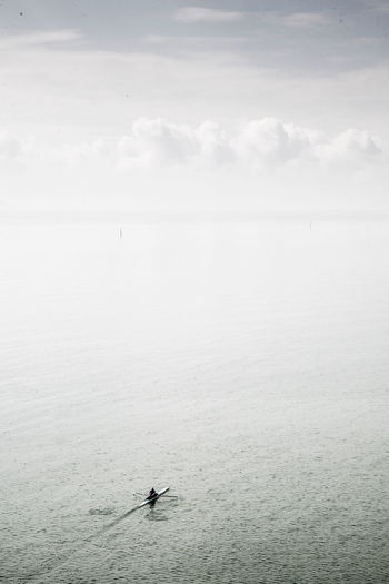High angle view of man sculling in sea