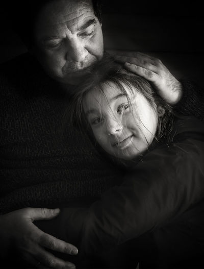 Father and daughter embracing