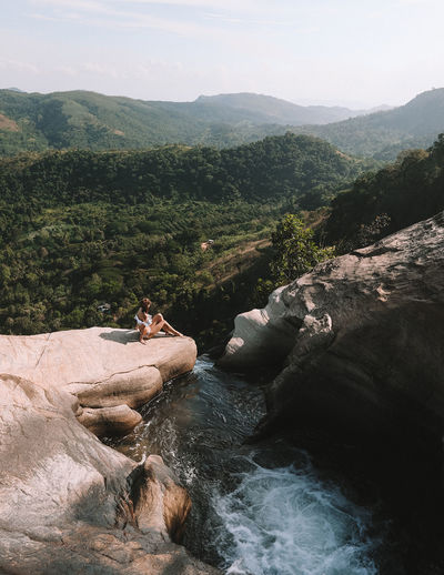 High angle view of woman sitting on mountain by diyaluma falls