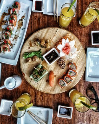 High angle view of food served on wooden table