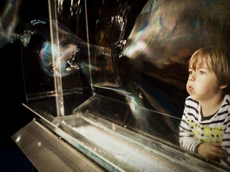 Boy Bursting Bubble Bursting Bubbles Casual Clothing Close-up Focus On Foreground Headshot Illuminated Leisure Activity Lifestyles Portrait Science Seifenblasen Technorama Winterthur
