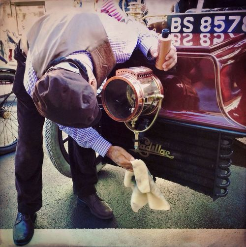 Buffing up the cadillac at the Regent St motorshow. NEM Boundlesslove Street Photography StreetsWithPeople NEM Street