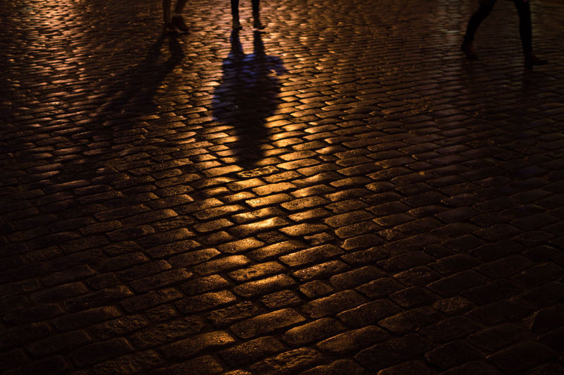 Poland Warsaw Europe Street Cobblestone Night High Angle View Pattern City Shadow Nature Water No People Illuminated Outdoors Footpath Reflection Wet Textured  Low Section Brick Paving Stone Focus On Shadow