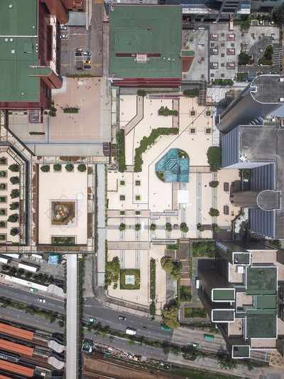 High angle view of road by buildings in city