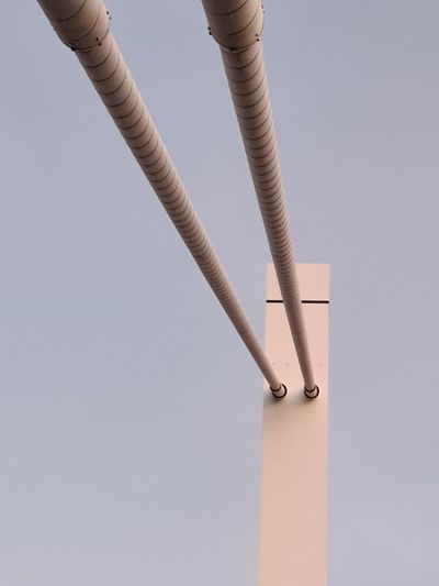 Low angle view of pipe against clear sky