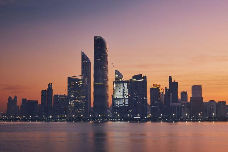 Urban skyline with skyscrapers at beautiful dawn. cityscape abu dhabi, uae.
