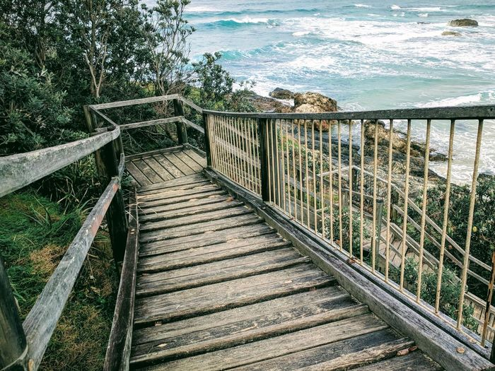 High angle view of wooden footbridge at beach