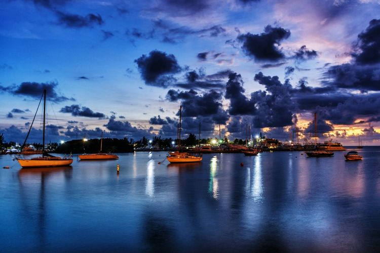 Overnight Success Nautical Vessel Water Boat Illuminated Tranquil Scene Transportation Dusk Sky Tranquility Scenics Mode Of Transport Cloud Waterfront Cloud - Sky Sea Non-urban Scene Nature Beauty In Nature Calm Blue light and reflection My Year My View