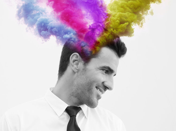 Business man smiling with colorful smoke explode out of his head. Creativity, emotion controlling concept Collage Creative Light and Shadow Creativity Emotions Vivid Adult Art Brunette Businessman Colorful Controlling Enjoy Life Exploding Good Mood Grey Headshot Ideas Multi Colored One Person People Real People Shirt And Tie Smartphonephotography Smiling Studio Shot