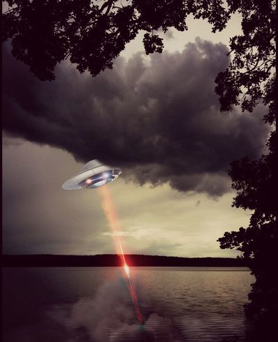 UFO Darksky Clouds Lake Lake View Outdoors 🛸👽 photo by Paul edit by me🛸🛸🛸thank you Paul for letting me use your photo! I love that lake and the dark clouds were perfect for a UFO sighting!👽